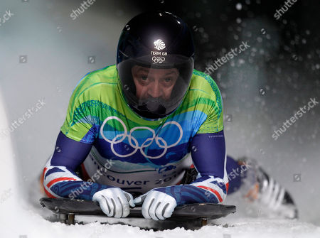 Kristan Bromley of Great Britain brakes in the finish area during the men's skeleton competition at the Vancouver 2010 Olympics in Whistler, British Columbia