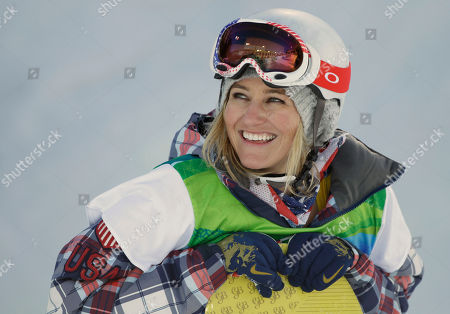 Gretchen Bleiler of the USA smiles as she compete in the women's snowboard halfpipe at the Vancouver 2010 Olympics in Vancouver, British Columbia