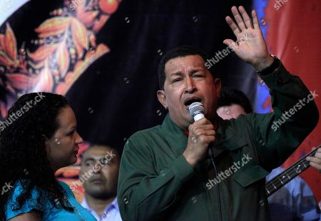 Hugo Chavez, Rosa Virginia Chavez Venezuela's President Hugo Chavez sings as his daughter Rosa Virginia Chavez looks on at an agreement signing ceremony with Bolivia's President Evo Morales, unseen, in Barinas, Venezuela
