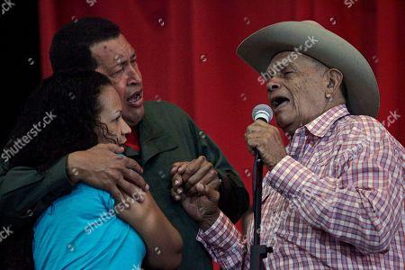 Hugo Chavez, Rosa Virginia Chavez, Eladio Tarife Venezuelan artist Eladio Tarife, right, sings with Venezuela's President Hugo Chavez and Chavez's daughter Rosa Virginia Chavez at an agreement signing ceremony with Bolivia's President Evo Morales, unseen, in Barinas, Venezuela