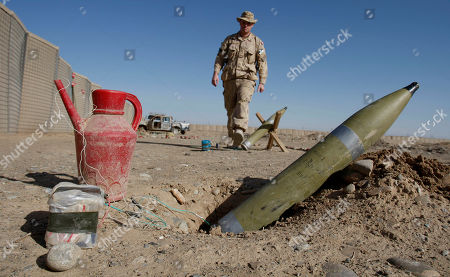 Maj. Chris Cotton from Judique Cape Breton, Nova Scotia of the Canadian Counter Improvised Explosive Device Squadron (CIED), is seen behind a rocket device set up for training purposes at Camp Hero in Kandahar, southern Afghanistan