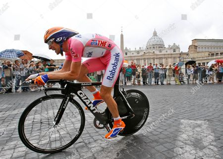 Denis Menchov Russia's Denis Menchov pedals as St. Peter's Basilica is seen in background, during the last stage of the Giro d'Italia, Tour of Italy cycling race, an individual time trial in Rome. Extending the fallout from the Lance Armstrong doping report, at least 15 more cyclists are being linked to the American's banned physician in what is unfolding as an intricate scheme of money laundering, tax evasion and widespread doping. The Gazzetta dello Sport reports that former Giro d'Italia winners Michele Scarponi and Denis Menchov, plus this year's Olympic champion Alexandre Vinokourov, are under investigation for doping under the supervision of Dr. Michele Ferrari