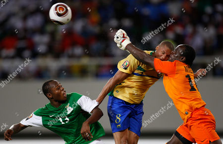 Gabon's captain Daniel Cousin, center, collides with Zambia's goalkeeper Kennedy Mweene, right, as his teammate Stoppila Sunzu, left, looks on during their African Cup of Nations Group D soccer match at the Ombaka National Stadium in Benguela, Angola, . Zambia beat Gabon 2-1