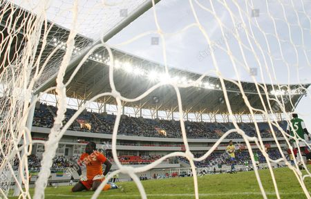 Zambia's goalkeeper Kennedy Mweene looks on after a goal attempt from Gabon's captain Daniel Cousin, unseen, during their African Cup of Nations Group D soccer match at the Ombaka National Stadium in Benguela, Angola, . Zambia beat Gabon 2-1