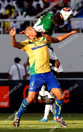 Gabon's captain Daniel Cousin, left, and Zambia's Thomas Nyirenda, top, challenge for the ball during their African Cup of Nations Group D soccer match at the Ombaka National Stadium in Benguela, Angola