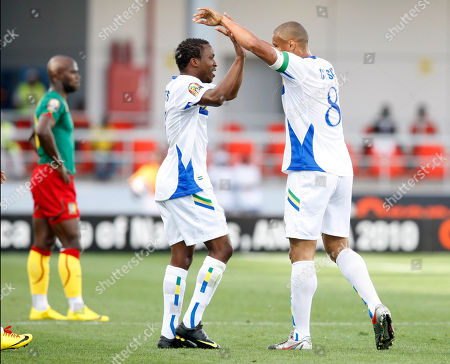 Gabon's Daniel Cousin, right, is congratulated by a teammate after scoring against Cameroon in their African Cup of Nations Group D soccer match at Tundavala Stadium in Lubango, Angola