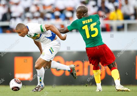 Daniel Cousin, Pierre Webo Gabon's Daniel Cousin attacks past Cameroon's Pierre Webo during their African Cup of Nations Group D soccer match at Tundavala Stadium in Lubango, Angola