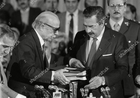 Raul Alfonsin, Ernesto Sabato Argentina's former President Raul Alfonsin, right, receives a human rights report from Argentinean writer Ernesto Sabato in Buenos Aires. Sabato, who led the government's probe of crimes committed by Argentina's dictatorship, died, at 99 of complications of bronchitis, his friend and collaborator Elvira Gonzalez Fraga told local media
