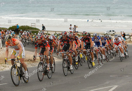 Stock Photo of Andre Greipel Tour leader Andrea Greipel of Germany, left, leads riders in the main peloton round a turn during stage five of the Tour Down Under Cycling event in Snapper Point, Australia, . Luis Leon Sanchez of Spain from team Caisse D'epargne-Spain won the 148-kilometer stage with Andre Gripel of Germany from team HTC-Columbia-USA, retaining the leader's jersey for the fifth day