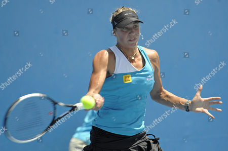 Belgium's Yanina Wickmayer returns the ball to Britain's Naomi Cavaday in an Australian Open Women's singles 2nd round qualifying tennis match in Melbourne, Australia