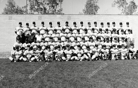 View of Cleveland Indians baseball teams in 1963: Front Row: Hector Cardenas, Mike de la Hoz, Gordon Seyfried, Bob Lipski, Vic Davalillo, Tony Martinez, Billy Consolo, Millie Tasby, Gordon Lund, Tommy Agee, Milt-Swift, Jack Curtis, Max Alvis. Second Row: Fred Whitfield, Enrique Gazmuri, Jim Grant, Pedro Ramos, Dave Tyriver, Elmer Valo, coach; George Strickland, coach; Birdie Tebbetts, manager; Mel Harder, coach; Ray Dabek, spring training coach; John Romano, Lee Green, Tito Francona, Woodie Held, Charlie Morris, traveling secretary. Third Row: Nate Wallack, public relations director; Ron Krauza, equipment manager; Wallie Bock, trainer; Gary Bell; Georges Maranda, Bob Allen, Gene Green, Jerry Walker, Hal Jones, Jerry Kindall, Ty Ckine, John spring training coach: Bill Cooper, spring assistant trainer. Fourth Row: Barry Latman, Doc Edwards, Floyd Weaver, Ron Nischwitz, Bill Dailey, Casey Cox, Walter Bond, Joe Adcock, Sam McDowell, Dick Donovan, Jim Perry, Macon Lowe, Tommy John, Joe Schaffernoth, Sonny Siebert, Steve Hargan