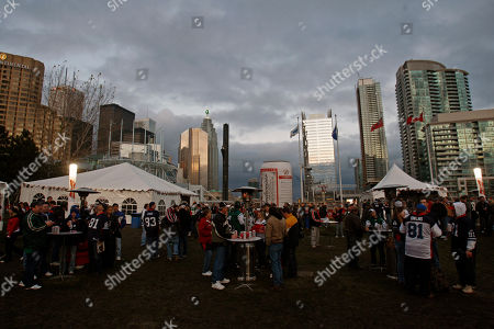 Stock Image of Fans tailgating before an NFL football game between the Buffalo Bills and the New York Jets in Toronto. In announcing a $78.5 million deal to have the Buffalo Bills play eight games in Toronto, the late Ted Rogers two years ago envisioned full houses and fans lining up for blocks to buy tickets