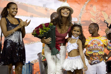 Julia Lira, Juliana Paes, Quiteria Chagas Julia Lira, 7, and former drum queens Juliana Paes, center, and Quiteria Chagas are seen during a rehearsal of the Viradouro samba school in Rio de Janeiro, Wednesday, Feb.3, 2010. The tiny dancer will be at the helm of the Viradouro samba school's parade _ which has been known for attracting attention in the past for an ill-fated Holocaust-themed float and for having local superstar actresses like Juliana Paes and Luma de Oliveira at the front of their shows
