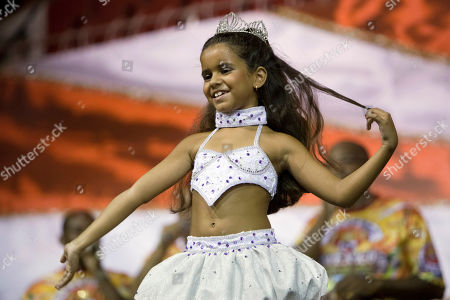 Julia Lira Julia Lira, 7, performs during a rehearsal of the Viradouro samba school in Rio de Janeiro, Wednesday, Feb.3, 2010. The tiny dancer will be at the helm of the Viradouro samba school's parade _ which has been known for attracting attention in the past for an ill-fated Holocaust-themed float and for having local superstar actresses like Juliana Paes and Luma de Oliveira at the front of their shows