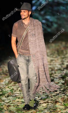Caua Reymond Brazilian actor Caua Reymond wears a creation by Colcci during the Sao Paulo Fashion Week Fall Winter collection, in Sao Paulo