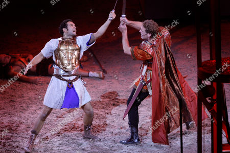 German actor Sebastian Thrun, left, who plays Judah Ben Hur, performs a scene from the world premiere of the stage extravaganza Ben Hur Live at the O2 centre, London, . Based on the 1880 novel by Lewis Wallace which in turn led to the Charlton Heston screen epic, the performances - lasting just under two hours - re-enact the vengeance and redemption tale set at the time of Christ. The 1959 film adaptation starring Carlton Heston as Judah Ben Hur, won 11 Oscars