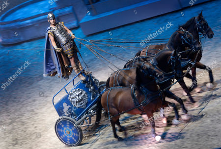 The chariot race scene is performed from the world premiere of the stage extravaganza Ben Hur Live at the O2 centre, London, . Based on the 1880 novel by Lewis Wallace which in turn led to the Charlton Heston screen epic, the performances - lasting just under two hours - re-enact the vengeance and redemption tale set at the time of Christ. The 1959 film adaptation starring Carlton Heston as Judah Ben Hur, won 11 Oscars