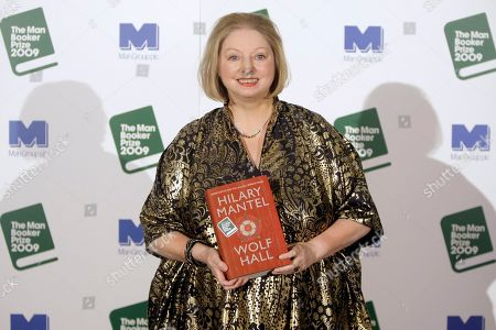Hilary Mantel Winner of the 2009 Booker Prize for fiction Hilary Mantel with their book 'Wolf Hall'' poses for photographers following the announcement in central London, .The books shortlisted for the 2009 Booker Prize were- AS Byatt - The Children's Book, JM Coetzee - Summertime, Adam Foulds - The Quickening Maze, Hilary Mantel - Wolf Hal,l Simon Mawer - The Glass Room and Sarah Waters - The Little Stranger . The winner receives a prize of 52,500 pounds, (US$ 83,500 euro 56,750