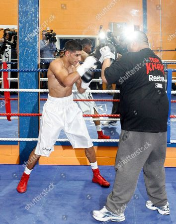 Amir Khan British boxer Amir Khan, is seen training at the Gloves Community Centre, Bolton, England, . Khan is due to fight Mexican Marco Antonio Barrera at the M.E.N Arena in Manchester on March 14
