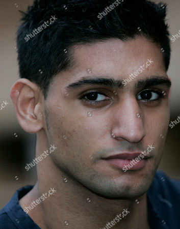 Amir Khan British boxer Amir Khan listens to a question from the media as his fight with Mexico's Marco Antonio Barrera is announced in London, . The fight will take place at a venue to be decided on March 14