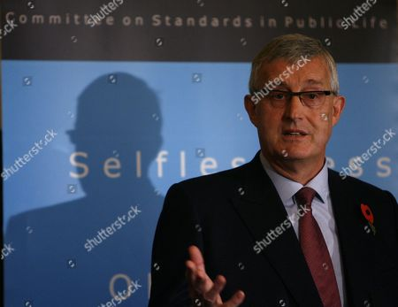 Christopher Kelly, chairman of the Committee on Standards in Public Life, speaks during a press conference in London, . Proposals to slash lawmakers' allowances and tighten the expense system have been published in London Wednesday following the British lawmakers' scandals on their expenses