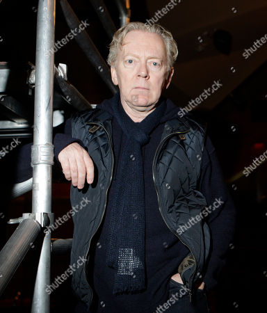 "Bob Crowley In this Feb. 8, 2010 photo, set designer Bob Crowley, of ""Love Never Dies,"" the musical sequel to ""The Phantom of the Opera,"" poses at the Adelphi Theatre in London, . The musical is scheduled to open at the Adelphi in the West End on March 9 and on Broadway on November 11"