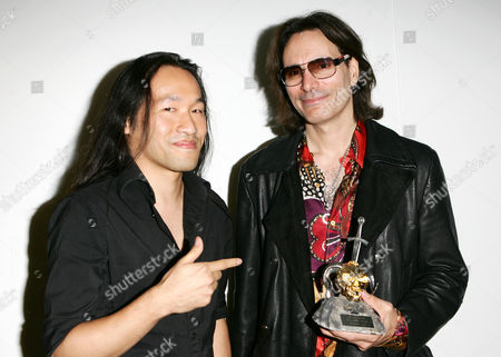 Herman Li, Steve Vai Herman Li of the band Dragonforce and Musician Steve Vai with his Riff Lord award at the Metal Hammer Gods Awards 2009 in London, England