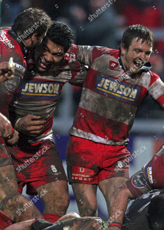 Stock Image of Lesley Vainikolo, Rory Lawson Gloucester's Lesley Vainikolo, center, and Rory Lawson, right, celebrate after a try is scored against Biarritz during their European Rugby Cup Round five rugby match at the Kingholm Stadium, Gloucester, England