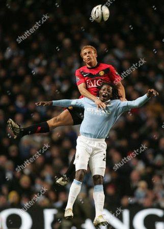 Wes Brown, Benjani Mwaruwari Manchester City's Benjani Mwaruwari, bottom, vies for the ball against Manchester United's Wes Brown during their English League Cup semi final first leg soccer match at City of Manchester Stadium, Manchester, England, . (AP Photo/Tim Hales) ** NO INTERNET/MOBILE USAGE WITHOUT FOOTBALL ASSOCIATION PREMIER LEAGUE (FAPL) LICENCE. CALL +44