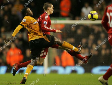 Sylvan Ebanks-Blake, Daniel Agger Liverpool's Daniel Agger, behind, vies for the ball against Wolverhampton's Sylvan Ebanks-Blake during their English Premier League soccer match at Anfield, Liverpool, England, . (AP Photo/Tim Hales) ** NO INTERNET/MOBILE USAGE WITHOUT FOOTBALL ASSOCIATION PREMIER LEAGUE (FAPL) LICENCE. CALL +44