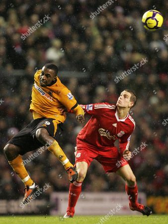 Sylvan Ebanks-Blake, Daniel Agger Liverpool's Daniel Agger, right, vies for the ball against Wolverhampton's Sylvan Ebanks-Blake during their English Premier League soccer match at Anfield, Liverpool, England, . (AP Photo/Tim Hales) ** NO INTERNET/MOBILE USAGE WITHOUT FOOTBALL ASSOCIATION PREMIER LEAGUE (FAPL) LICENCE. CALL +44