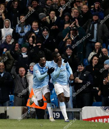 Manchester City's Micah Richards, right, reacts with teammate Benjani Mwaruwari after scoring against Blackburn during their English Premier League soccer match at The City of Manchester Stadium, Manchester, England, . (AP Photo/Jon Super) ** NO INTERNET/MOBILE USAGE WITHOUT FOOTBALL ASSOCIATION PREMIER LEAGUE (FAPL) LICENCE. CALL +44