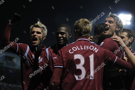 West Ham's Matthew Upson, obscured, celebrates with teammates including Valon Behrami, left, Frank Nouble, second left, Jack Collison, 31, and Radoslav Kovac, right, after scoring against Portsmouth during the English Premier League soccer match at Fratton Park stadium in Portsmouth, . The game finished 1-1. (AP Photo/Matt Dunham) ** NO INTERNET/MOBILE USAGE WITHOUT FOOTBALL ASSOCIATION PREMIER LEAGUE(FAPL)LICENCE. CALL +44