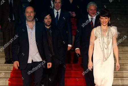 """Cedric Klapisch, Roman Duris, Juliette Binoche From left to right, French Director Cedric Klapisch, French actor Roman Duris and French actress Juliette Binoche walk the red carpet ahead of the screening of the movie """"Paris"""" at the opening of the French Film Festival in Beijing, China"""