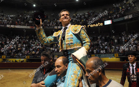 "Julian Lopez Escobar, El Juli Spain's bullfighter Julian Lopez Escobar, ""El Juli"", is carried by fans after his performance at La Macarena bullring in Medellin, Colombia"