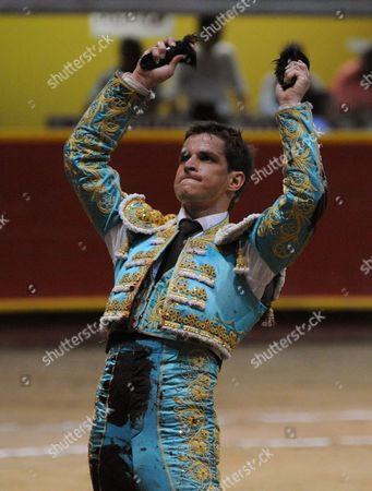 "Julian Lopez Escobar, El Juli Spain's matador Julian Lopez Escobar, ""El Juli"", shows his trophy, two ears, after his performance at La Macarena bullring in Medellin, Colombia"