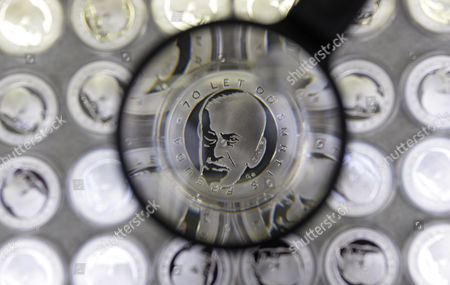 Medal, seen through magnifying glass, commemorating 70th anniversary of death of Austrian founder of psychoanalysis Sigmund Freud, designed by his great-granddaughter British artist Jane McAdam Freud, is displayed in Jablonec nad Nisou, Czech Republic . Freud died on Sept. 23, 1939