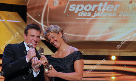 "Stock Photo of Paul Biedermann, Steffi Nerius Der Schwimmer Paul Biedermann, links, und die Speerwerferin Steffi Nerius, rechts, sind am Sonntag, 20. Dezember 2009, bei der Gala ""Sportler des Jahres"" in Baden-Baden zu sehen. Sie wurden zu den Sportlern des Jahres 2009 gewaehlt. (AP Photo/Daniel Roland) ---German swimmer Paul Biedermann, left, and javelin thrower Steffi Nerius, right, are seen at the awarding ceremony ""Germany's Sportsman of the Year"" in Baden-Baden, Germany, on . Both have been elected German Sportsman/Sportswoman of the Year"
