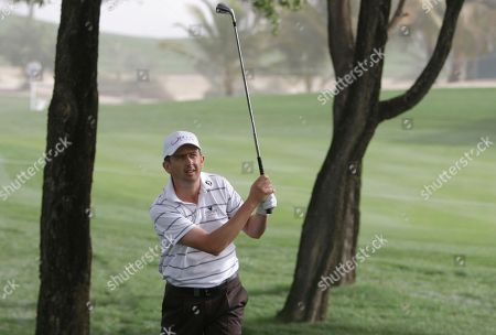 Ireland's Peter Lawrie watches his shot on the 9th hole during the 1st round of Dubai Desert Classic in Dubai, United Arab Emirates