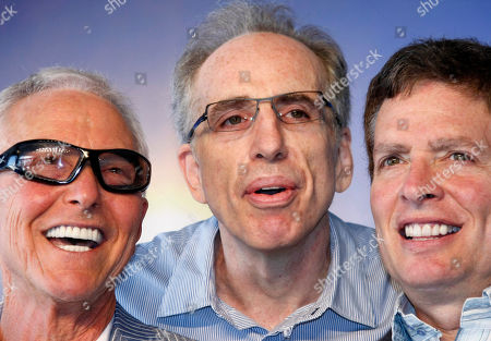U.S. directors, producers and screenwriters Jim Abrahams, left, Jerry Zucker, center, and David Zucker, right, pose during a photocall ahead of a tribute award for their careers in film at the 35th American Film Festival, in Deauville, Normandy, France