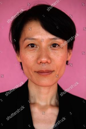 Ounie Lecomte Korean-born French director Ounie Lecomte poses for photographs during the 62nd International film festival in Cannes, southern France, . Lecomte is presenting 'A Brand New Life' at the 62nd edition of the Cannes film festival