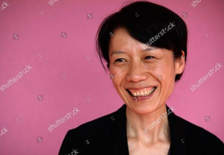 Stock Image of Ounie Lecomte Korean-born French director Ounie Lecomte poses for photographs during the 62nd International film festival in Cannes, southern France, . Lecomte is presenting 'A Brand New Life' at the 62nd edition of the Cannes film festival