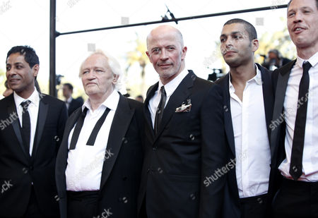 Reda Kateb, Adel Bencherif, Jacques Audiard, Niels Arestrup, Hichem Yacoubi French actors Reda Kateb, right, Adel Bencherif, second from right, French director Jacques Audiard, center, French actors Niels Arestrup, second from left, and Hichem Yacoubi, left, arrive on the red carpet for the screening of 'Un Prophete' (A Prophet), during the 62nd International film festival in Cannes, southern France