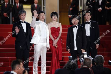 Kore-Eda Hirokazu, Arata, Bae Doo-Na Japanese Director Kore-Eda Hirokazu, second right, stands with cast members from right, Japanese actor Arata, South Korean actress Bae Doo-Na and Japanese actor Itao Itsuji as they arrive for the screening of the film 'Kuki Ningyo' (Air Doll) during the 62nd International film festival in Cannes, southern France