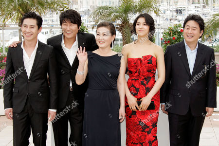 Shin Ha-Kyun, Song Kang-Ho, Kim Hae-Sook, Kim Ok-Vin, Park Chan-Wook From left, South Korean actors Shin Ha-Kyun, Song Kang-Ho, Kim Hae-Sook, Kim Ok-Vin and South Korean director Park Chan-Wook react as they attend a photo call for the film 'Bak-Jwi' (Thirst) during the 62nd International film festival in Cannes, southern France