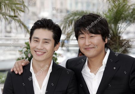 Shin Ha-Kyun, Song Kang-Ho From left, South Korean actors Shin Ha-Kyun and Song Kang-Ho react as they attend a photo call for the film 'Bak-Jwi' (Thirst) during the 62nd International film festival in Cannes, southern France