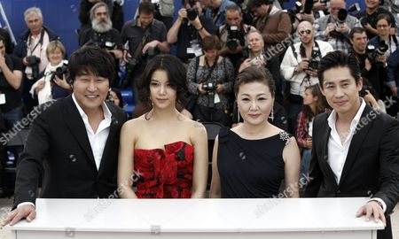 Song Kang-Ho, Kim Ok-Vin, Kim Hae-Sook, Shin Ha-Kyun From left, South Korean actor Song Kang-Ho, South Korean actress Kim Ok-Vin, South Korean actress Kim Hae-Sook and South Korean actor Shin Ha-Kyun pose during a photo call for the film 'Bak-Jwi' (Thirst) at the 62nd International film festival in Cannes, southern France
