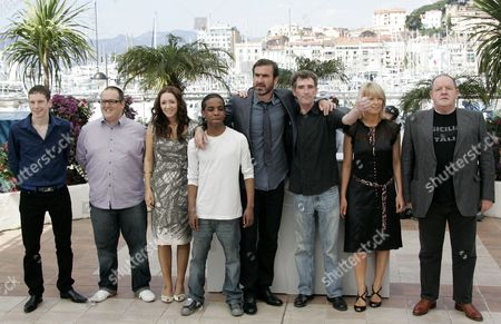 Gerard Kearns, Justin Moorhouse, Stefan Gumbs, Eric Cantona, Steve Evets, Stephanie Bishop, John Henshaw From left, British Gerard Kearns, British actor Justin Moorhouse, British actress Lucy-Jo Hudson, British Stefan Gumbs, French actor and former soccer player Eric Cantona, British actor Steve Evets, British actress Stephanie Bishop, and British actor John Henshaw, pose during a photo call for the film 'Looking for Eric', during the 62nd International film festival in Cannes, southern France