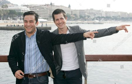 """Ennis Esmer, Craig Olejnik Turkish actor Ennis Esmer, left, and Canadian actor Craig Olejnik, pose for photographers during the MIPTV, an international entertainment content market, held annually in Cannes, southern, France . Esmer and Olejnik presents the hit show """"The Listener"""