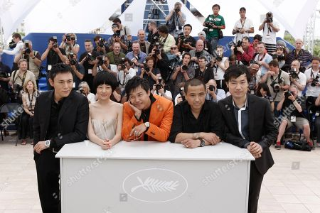 Wei Wu, Zhuo Tan, Hao Qin, Sicheng Chen Chinese actors Wei Wu, left, Zhuo Tan, second from left, Hao Qin, second from right, and Sicheng Chen, right, are seen during a photo call for the film 'Chun Feng Chen Zui De Ye Wan' (Spring Fever), during the 62nd International film festival in Cannes, southern France